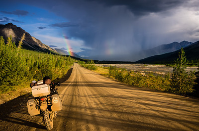 The Dalton Highway Rainbow Storm We take a short break while riding the Haul Road through the Brooks Range in Alaska. Time to get he rain suits on! The weather is unpredictable above the Arctic Circle.